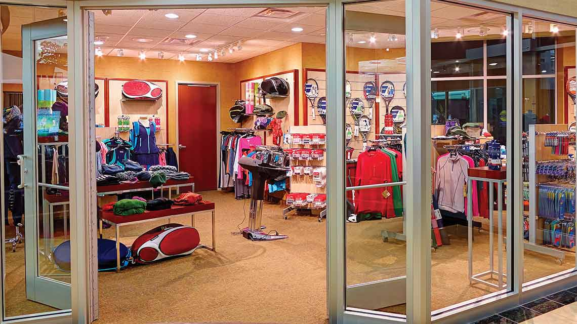 Tennis clothing and other merchandise in a pro shop