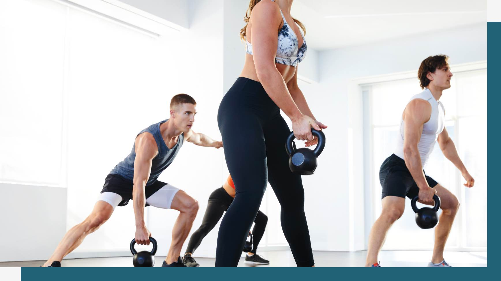 Group of people using kettlebells for a workout