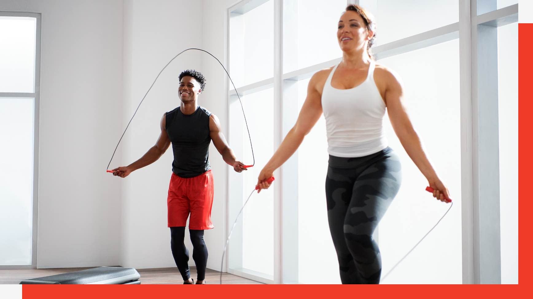 Two people jumping rope in a group fitness class at Life Time